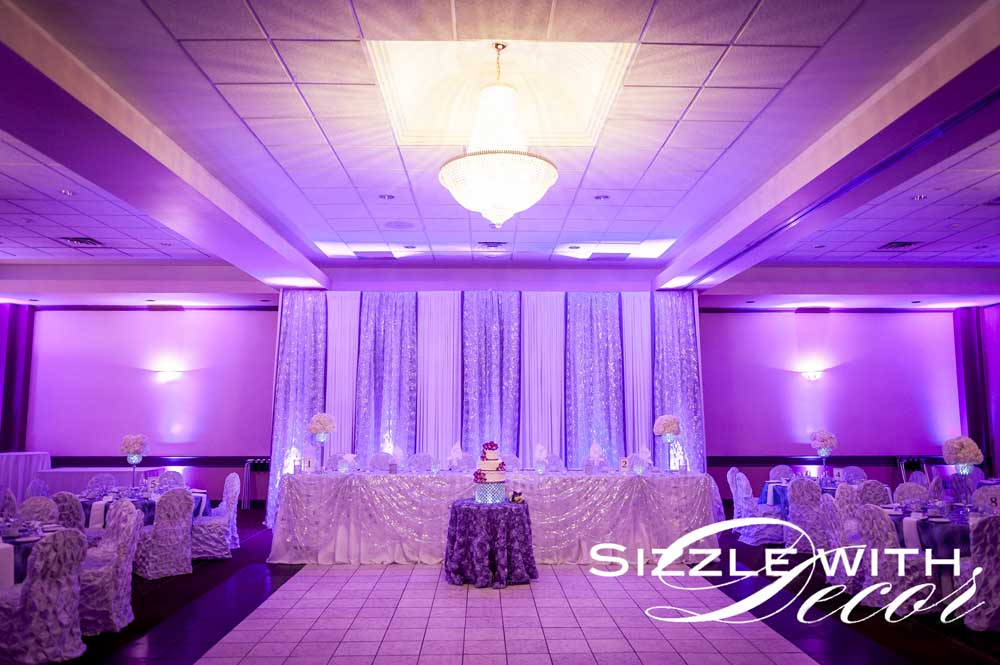 Purple and white wedding back drop hellenic centre